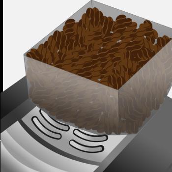 Der Bohnenbehälter eines Kaffeevollautomaten, gefüllt mit feinsten Kaffeebohnen.